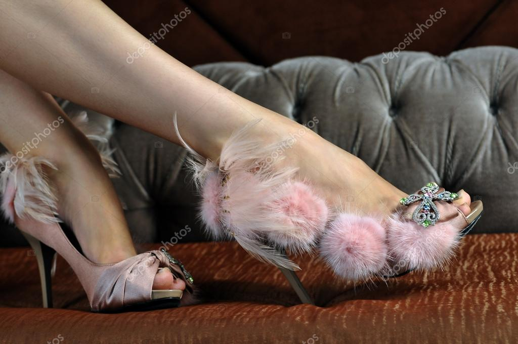 Model wearing couture designer shoes