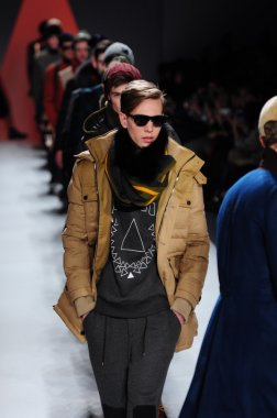 NEW YORK - FEBRUARY 10: Male models walk runway for General Idea Fall Winter 2012 presentation in Lincoln Center during New York Fashion Week on February 10, 2012
