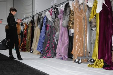 NEW YORK - FEBRUARY 11: Backstage view with dresses before Venexiana Fall Winter 2012 collection show at Lincoln center during New York Fashion Week on February 11, 2012 in NY