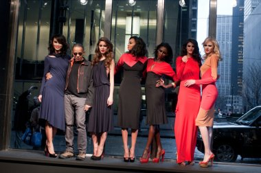 NEW YORK, NY - FEBRUARY 16: Designer Stephen Burrows (2nd L) pose with models at the Stephen Burrows fall 2012 fashion show during Mercedes-Benz Fashion Week on February 16, 2012 in New York