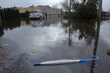 Dropped umbrella on the ground in the Sheapsheadbay neighborhood due to flooding from Hurricane Sandy