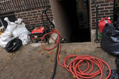 pumping water out of building basement in the Sheapsheadbay neighborhood due to flooding from Hurricane Sandy