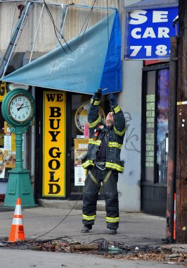 BROOKLYN, NY - NOVEMBER 01: NYFD fixing electrical wires at the Brighton Beach neighborhood due to impact from Hurricane Sandy in Brooklyn, New York, U.S., on Thursday, November 01, 2012.