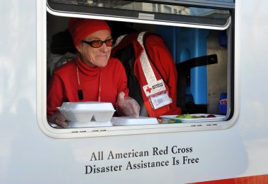 NEW YORK, NY - NOVEMBER 09: A mobile Red Cross unit supplies hot lunches for local in the Breezy Point part of Far Rockaway on November 9, 2012 in the Queens borough of New York City.