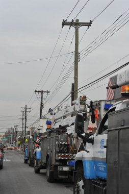 BROOKLYN, NY - NOVEMBER 11: Working out power problems in the Rockaway due to impact from Hurricane Sandy in Queens, New York, U.S., on Novemeber 11, 2012.