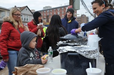 QUEENS, NY - NOVEMBER 11: getting help with hot food, clothes and supplies in the Rockaway beach area after impact from Hurricane Sandy in Queens, New York, U.S., on November 11, 2012.