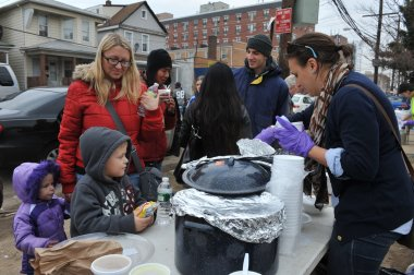 QUEENS, NY - NOVEMBER 11: Children getting help with hot food, clothes and supplies in the Rockaway beach area due to impact from Hurricane Sandy in Queens, New York, U.S., on November 11, 2012.
