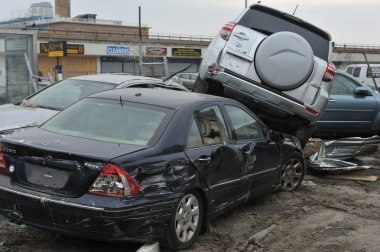 QUEENS, NY - NOVEMBER 11: Deamaged cars at parking lot in the Rockaway due to impact from Hurricane Sandy in Queens, New York, U.S., on Novemeber 11, 2012.