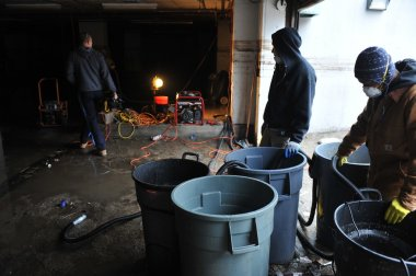 QUEENS, NY - NOVEMBER 11: Flooded basement and aftermath recovery in the Rockaway beach area houses due to impact from Hurricane Sandy in Queens, New York, U.S., on November 11, 2012.