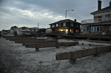 QUEENS, NY - NOVEMBER 11: Damaged homes and boardwalk aftermath recovery in the Rockaway beach area due to impact from Hurricane Sandy in Queens, New York, U.S., on November 11, 2012.