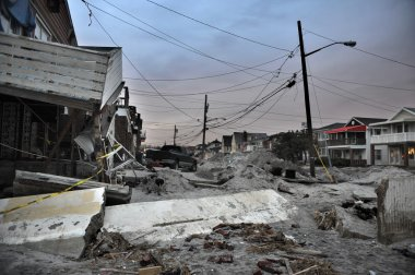 QUEENS, NY - NOVEMBER 11: Damaged houses without power at night in the Rockaway beach - Bel Harbor area due to impact from Hurricane Sandy in Queens, New York, U.S., on November 11, 2012.
