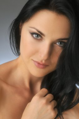 Attractive young brunette woman with blue eyes Closeup Portrait with soft filter