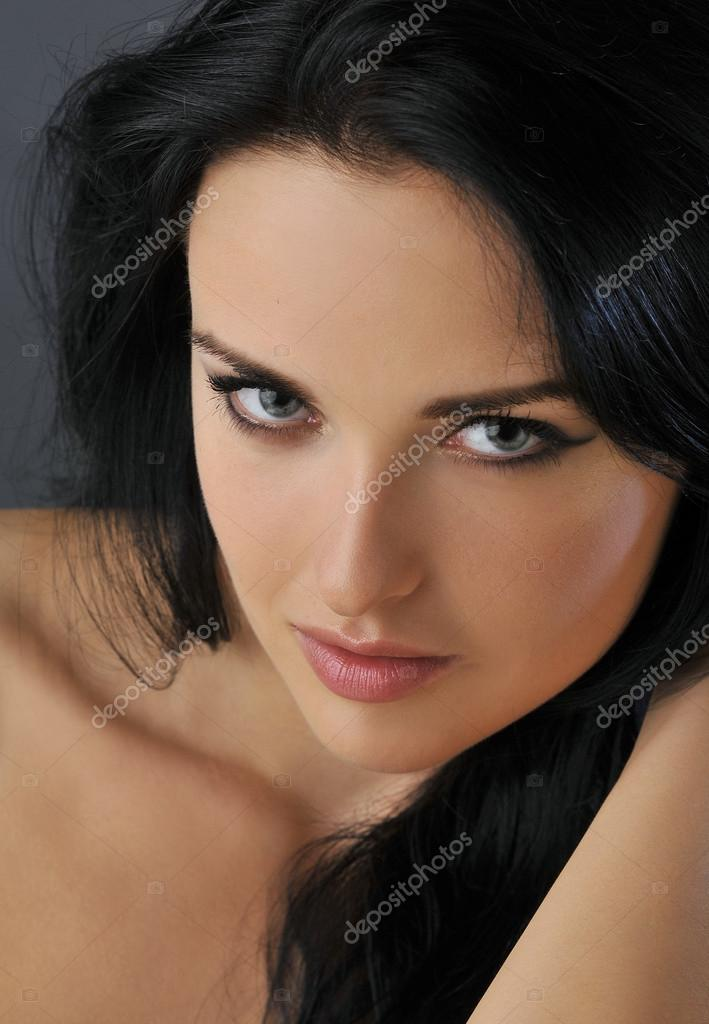 Attractive young brunette woman with blue eyes Closeup Portrait