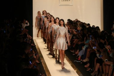 A models walks the runway at the Herve Leger By Max Azria Spring 2013 fashion show