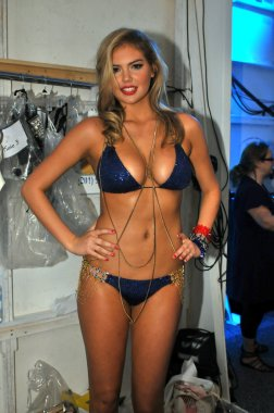 Model Kate Upton getting ready backstage at the Beach Bunny Swimsuit Collection