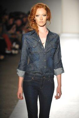 A model walks the runway at the DL 1961 Premium Denim spring 2013 fashion show