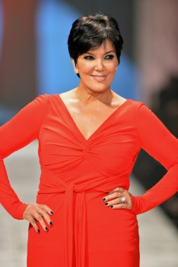 NEW YORK, NY - FEBRUARY 06: Kris Jenner wearing Badgley Mischka walks the runway at The Heart Truth's Red Dress Collection during Fall 2013 Mercedes-Benz Fashion Week on February 6, 2013, NYC.