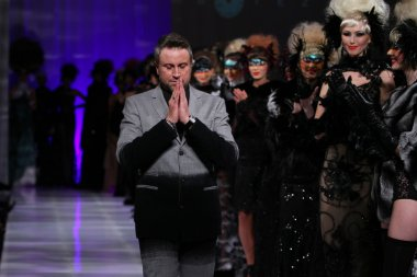 NEW YORK - FEBRUARY 15: Designer Catalin Botezatu walks on the Catalin Botezatu fashion runway at The New Yorker Hotel during Couture Fashion Week on February 15, 2013 in New York City