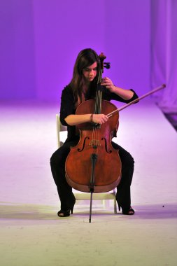 Los Angeles - March 13: Сellist plays the cello at Quynh Paris during STYLE Fashion Week at Vibiana Cathedral on March 13, 2013 in Los Angeles, CA