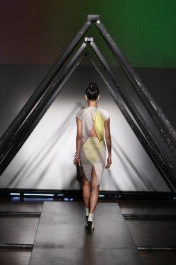 Model walks the runway at the Titania Inglis presentation