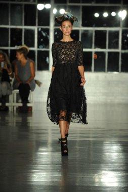 Model walks the runway at the K. Nicole fashion show