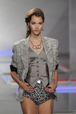 Model walks the runway at Rodarte show