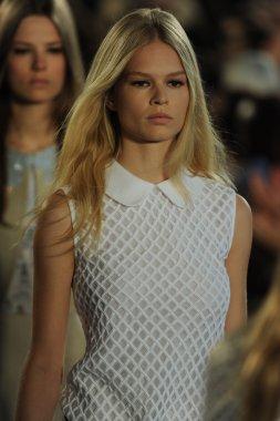 Model walks runway at Tory Burch fashion show