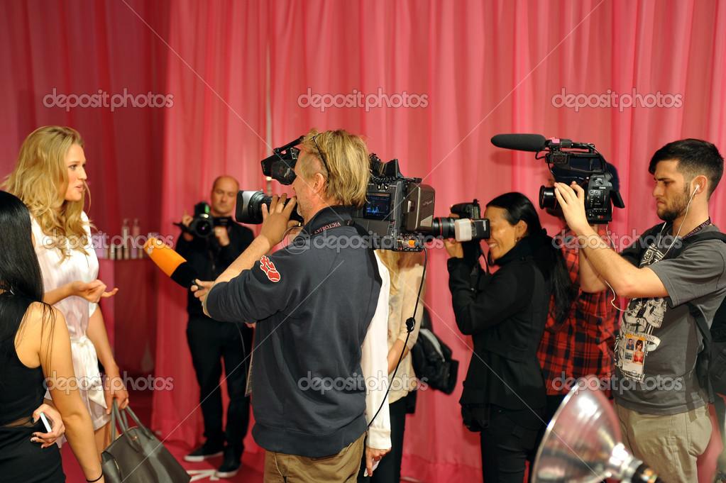 Toni Garrn giving interview