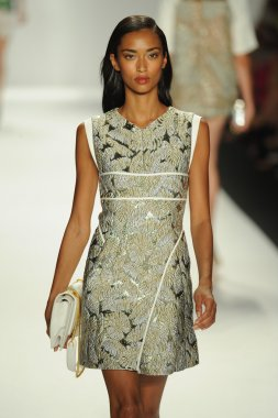 Model walks runway at J. Mendel show