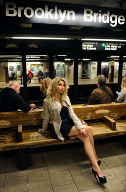 Attractive woman waiting for the train in NYC subway
