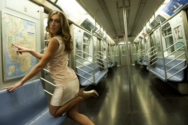 Girl wearing a short sexy dress in a subway train