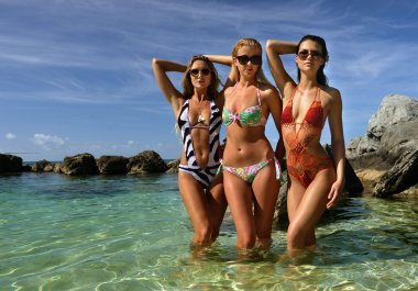Models posing in shallow water
