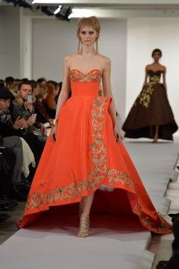 Model walks runway at Oscar De La Renta