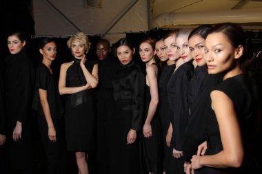 Models poses backstage at FLT Moda Art Hearts