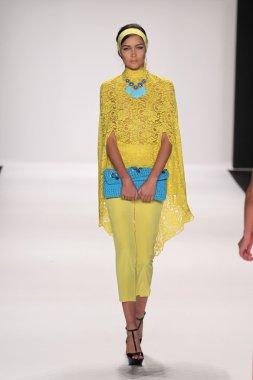 Model walks runway wearing Giada Curti
