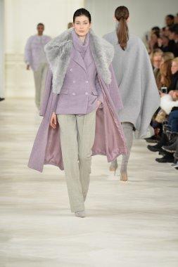 Model walks runway at Ralph Lauren show