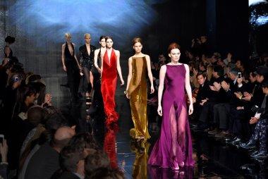 Models walk runway at Donna Karan New York