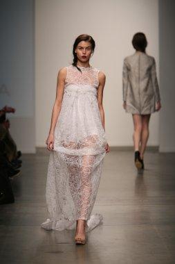 Model walks runway at Gabrielle Arruda show
