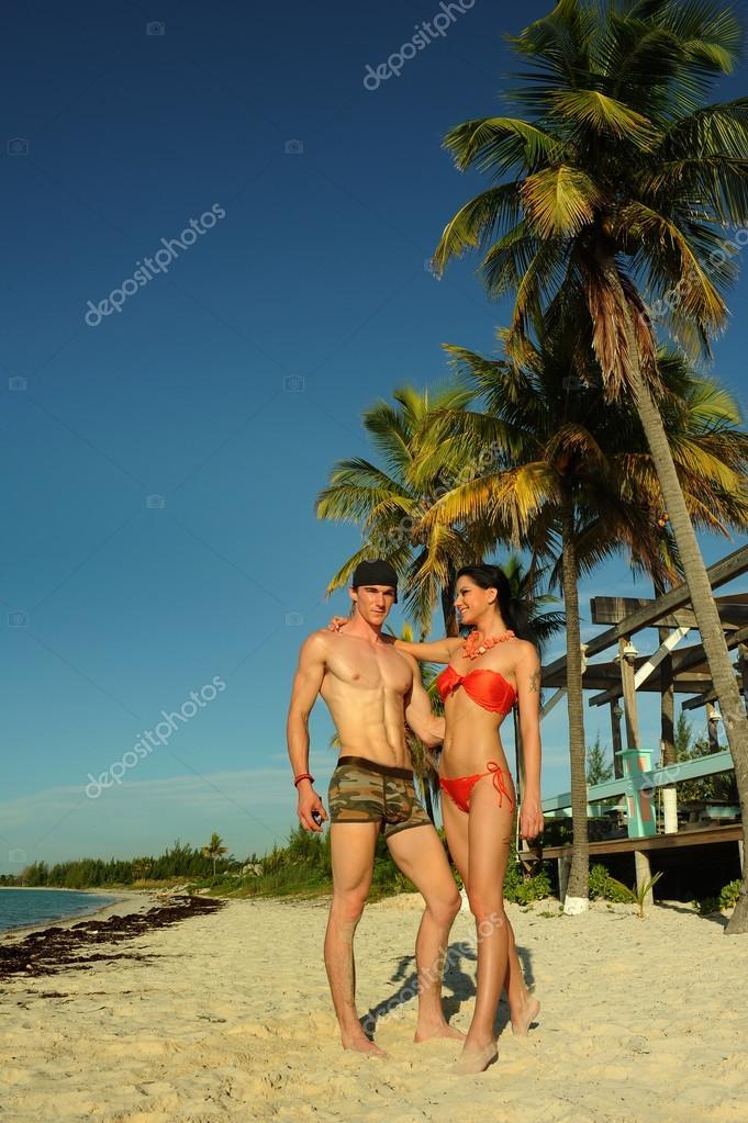 Couple feeling happy at tropical beach