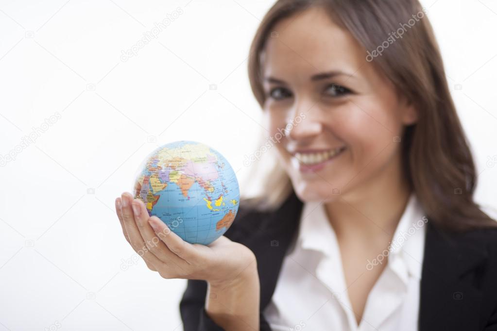 Business woman holding an earth model isolated on white background
