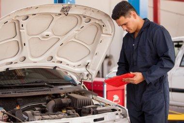 A mechanic checks the engine