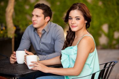 Brunette drinking coffee on a first date