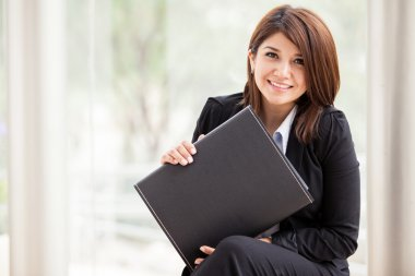 The image of the beautiful business woman with a briefcase