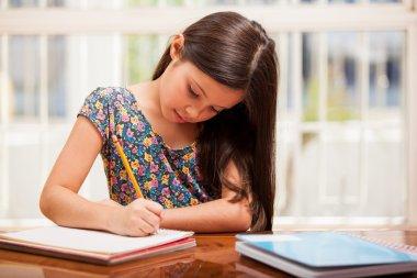 A little girl doing her homework