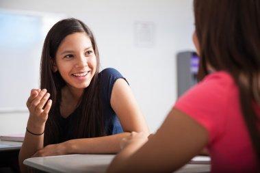 Teens talking in the classroom