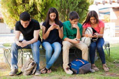 Teens busy with cell phones