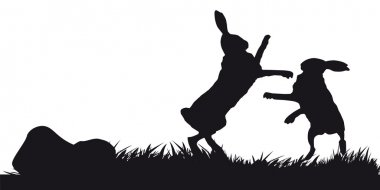 Hares hopping on grass - black and white silhouette