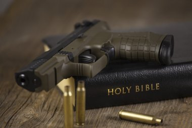 Pistol and Bible with empty bullets.