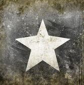 Fotografie Bílá hvězda na pozadí grunge