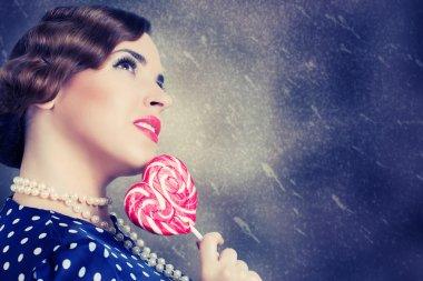 Woman with big lollipop